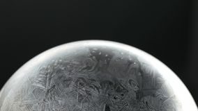 Snow Globe Snowflake Frosing and Defrosting. Frozing and Defrosing Snow Globe Snowflake. Ice patterns frosted on ball of soap frosting and defrosting against stock video