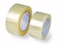 Förpackande band, två rullar av det genomskinliga bandet, isolerad bildnolla Royaltyfria Foton