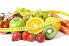 Frsh fruit and vegetables in measure tape Stock Image