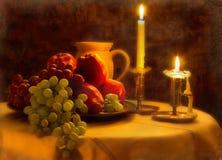 Frucht und Kerze, Weinlese. Stockfoto