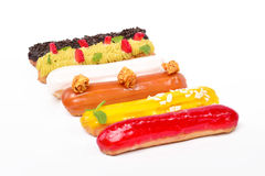 Fruchtfarbeeclairs Stockfotos