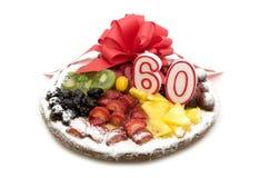 Fruchtkuchen mit Kerze Lizenzfreie Stockbilder
