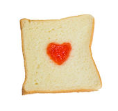 Fruchtmarmeladen-Herzform auf Scheibenbrot. Stockfoto