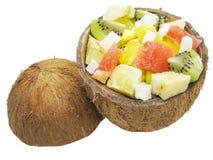Fruchtsalat in der Kokosnuss Stockbilder