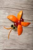 Fruchtschmetterling gemacht auf Holz Stockbilder