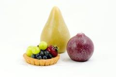 Fruchttörtchen und Kerzen, Ebene Lizenzfreie Stockfotos