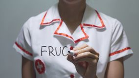 FRUCTURE, Female doctor writing on transparent screen stock video footage