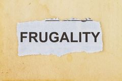 Frugality newspaper cutout. In an old paper background Stock Photo
