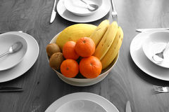 Fruit. Isolated colour fruit bowl on a dinner table, rest of photo in B&W Royalty Free Stock Photos