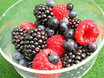 Fruit. Raspberries, blackberries and blueberries in a glass Royalty Free Stock Photos