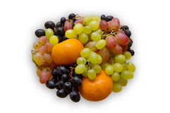 Fruit. Green grapes, red grapes, dark grapes, a tangerine Stock Photos