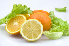 Fruit. A bunch of fruit and vegetables, including oranges, lemons and lettuce Royalty Free Stock Images