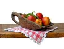 Fruit. Seasonal peach in wooden bowl Stock Images