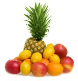 Fruit. A mound of fruit including pineapple, lemons, apples and oranges isolated on a white background Stock Photography