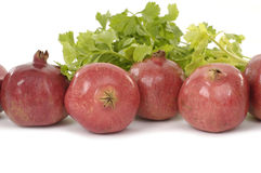 Fruit. Pomegranate fresh fruits with green vegetable leaves Royalty Free Stock Photo