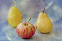 Fruit. Fresh red and yellow apples and pears Stock Photography