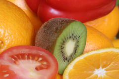 Fruit. Orange,  kiwi, tomate, close-up Stock Images