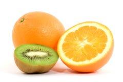 Fruit. Studio isolared - sliced kiwi and oranges Royalty Free Stock Photo