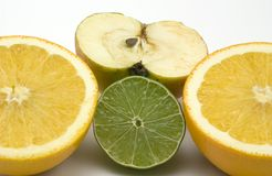 Fruit. Orange lime and apple cut in half Royalty Free Stock Photography