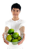 Fruit. Asian young man showing a healthy fruit Stock Photography