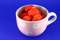 Water melon fruit in cup. Closeup of ripe water melon fruit in cup, blue background Stock Photography