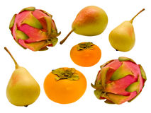 Fruit. Yellow pear, persimmon orange and pink and green fruit of the cactus on a white background Royalty Free Stock Image