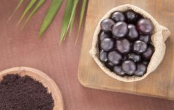 Fruit and acai powder - Euterpe oleracea Royalty Free Stock Image