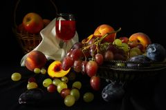 Fruit And A Glass Of Red Wine On A Dark Background Stock Images