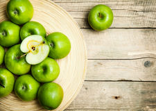 Fruit. apples in a bowl on wooden background Royalty Free Stock Images
