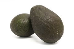 Fruit - Avocado. Two whole avocados with intentionally focus on the left avocado an Stock Image