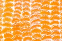 Fruit background. Mandarin segments as a background Royalty Free Stock Photo
