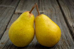 Fruit background. Fresh organic pears on old wood Royalty Free Stock Images