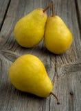 Fruit background. Fresh organic pears on old wood Royalty Free Stock Image