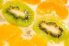 Fruit background. Kiwi and mandarin Royalty Free Stock Photo
