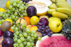 Fruit background. Background of ripe fruit apples oranges grapes Royalty Free Stock Photo