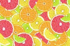 Fruit background with slices of orange, grapefruit, lemon, lime and kiwi. Royalty Free Stock Photo