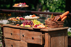 Fruit and bakery. The buffet table is decorated with fruits, sausages and bakery products Royalty Free Stock Image