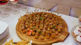 Fruit balls on skewers at the buffet. In the restaurant stock video footage