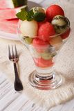 Fruit balls of watermelon, kiwi and melon decorated with mint Stock Images