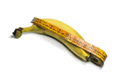 Fruit banana with measuring tape  on white background Royalty Free Stock Photos