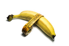 Fruit banana with measuring tape  on white background Stock Photography