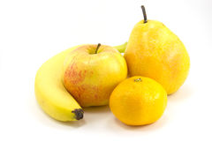 Fruit. Banana, pear, apple and tangerine insulated on white background Royalty Free Stock Images