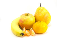 Fruit. Banana, pear, apple and tangerine insulated on white background Stock Photography