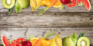 Fruit banner on wood background Royalty Free Stock Photos