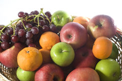Fruit basket. With grapes, green and red apples, mandarin and oranges Stock Photo
