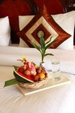 Fruit basket. On a bed stock photo