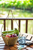 Fruit in basket. And water Royalty Free Stock Images