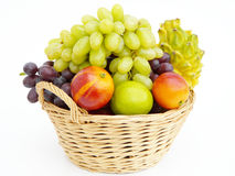 Fruit basket. Fresh fruits in a basket isolated on a white background Royalty Free Stock Photo