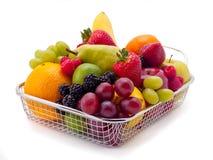 Fruit Basket. An arrangement of various fruits in a mesh basket Stock Photography