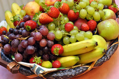 Fruit basket. Various colorful fresh fruits in a basket Royalty Free Stock Photo